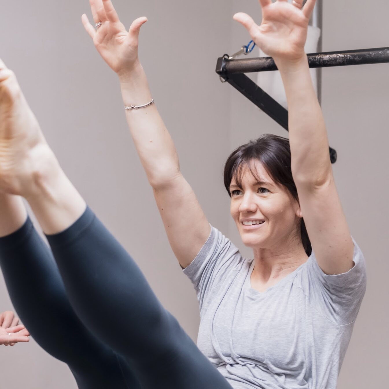 A testimonial photo of Leah working out in a Pilates studio